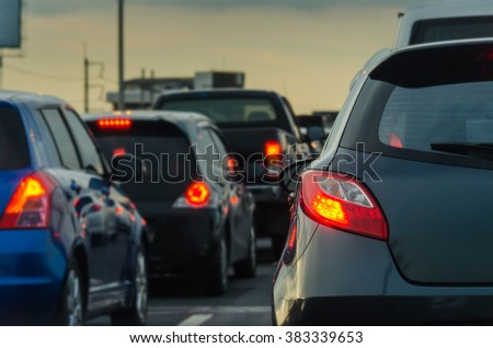 traffic jam with row of cars on expressway during rush hour #383339653