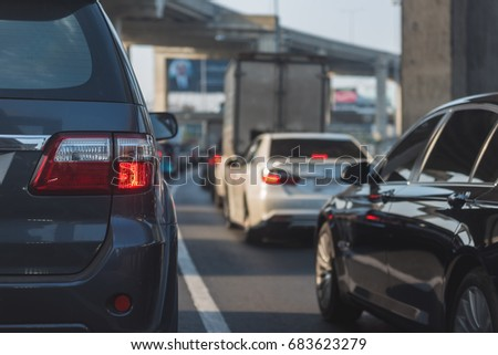 traffic jam with row of cars on toll way, during rush hour #683623279