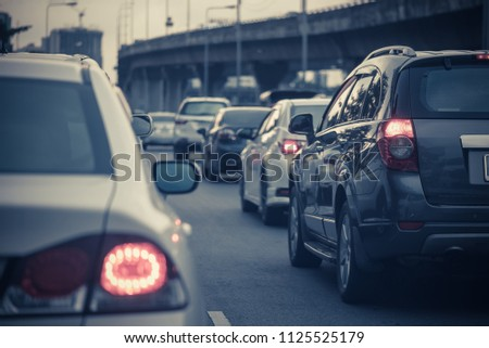 traffic jam with row of cars on toll way, rush hour, vintage process style