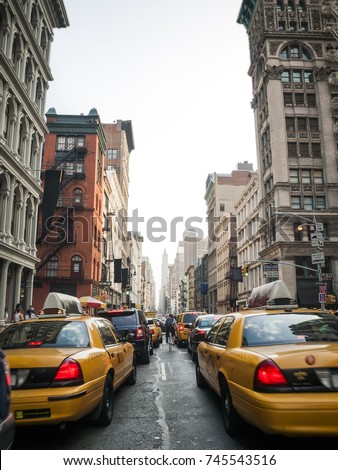 Traffic jam with yellow taxis in the soho neighborhood, Manhattan, New York City, United States #745543516