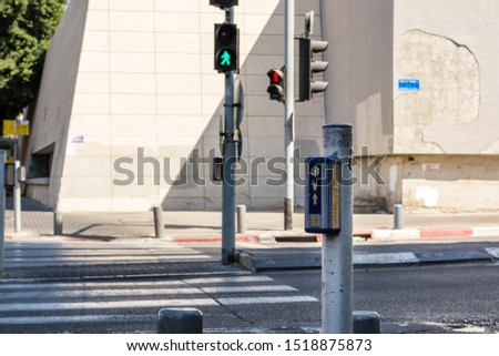 Traffic light control button with crosswalk scheme for blind people . Blind Pimple. Israel #1518875873