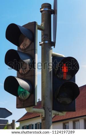 traffic light in bavarian city wangen summer sunshine day blue sky #1124197289
