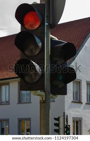 traffic light in bavarian city wangen summer sunshine day blue sky #1124197304