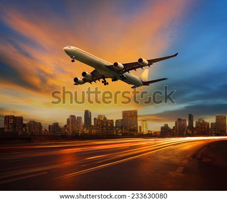 traffic light in land transportation and passenger airplane flying above urban scene use for transport business and  traveling theme