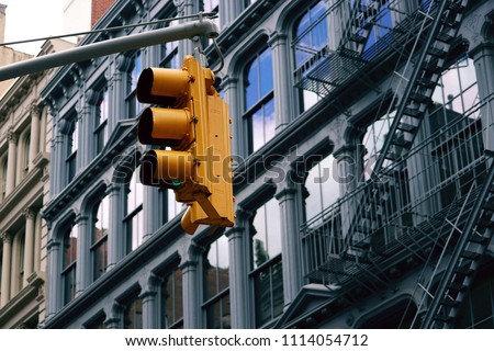 Traffic Light in SoHo Manhattan, Lofts with Fire Escapes in background
