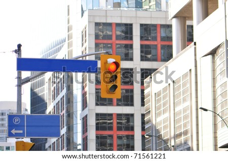 Traffic light on busy downtown intersection.
