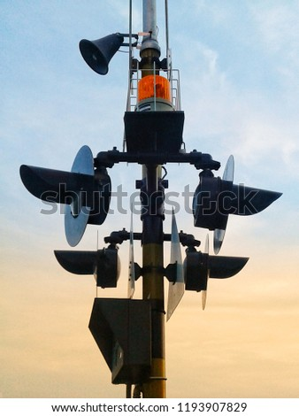 Traffic light post with speaker on the top