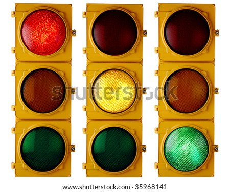 """Traffic light repeated three times, each with a different light """"on"""""""