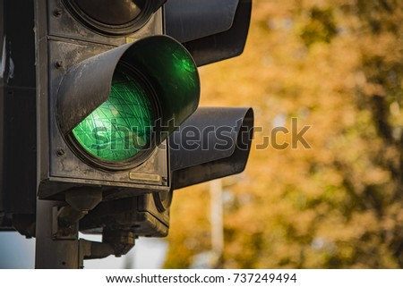 Traffic light showing green, signaling drivers to go #737249494