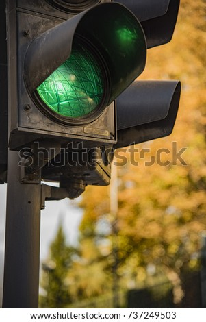 Traffic light showing green, signaling drivers to go #737249503