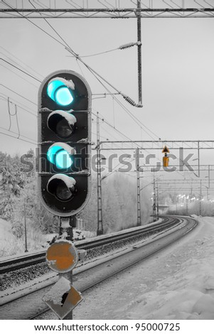 Traffic light shows green signal on railway