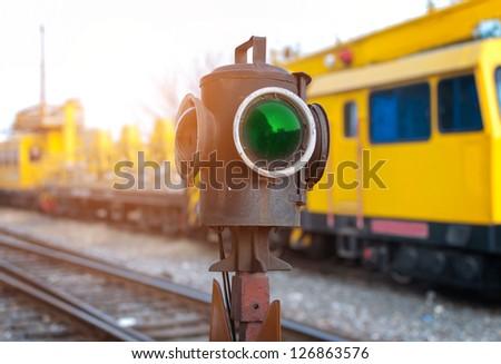 Traffic light shows green signal on railway. Green light