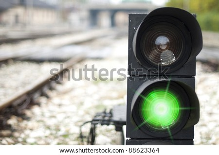 Traffic light shows green signal on railway. Green light