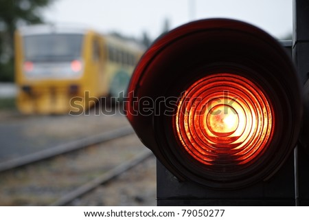 Traffic light shows red signal on railway. Railway station.