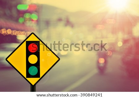 Traffic light sign on blur traffic road abstract background.Retro color style. #390849241