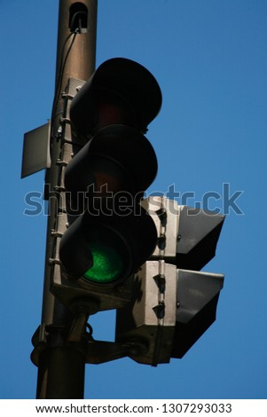 traffic light signaling the green color. with sky blue background #1307293033