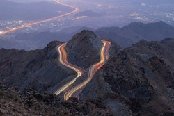 Traffic light trails wrapped around mountain on the zig zag road in Al Hada, Taif region of Saudi Arabia