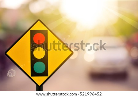 Traffic light warning sign on blur traffic road with colorful bokeh light abstract background. Copy space of transportation and travel concept. Retro tone filter color style. #521996452