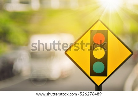 Traffic light warning sign on blur traffic road with colorful bokeh light abstract background. Copy space of transportation and travel concept. Retro tone filter color style. #526276489