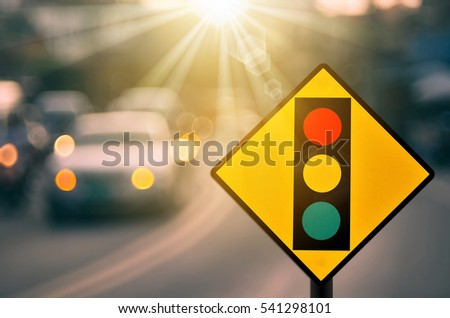 Traffic light warning sign on blur traffic road with colorful bokeh light abstract background. Copy space of transportation and travel concept. Retro tone filter color style. #541298101
