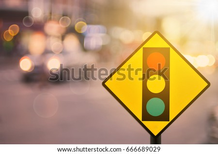 Traffic light warning sign on blur traffic road with colorful bokeh light abstract background. Copy space of transportation and travel concept. Retro tone filter color style. #666689029