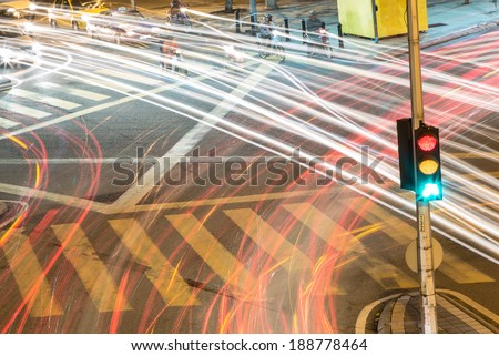 Traffic light with light streams from ongoing traffic