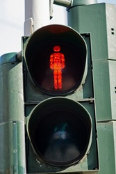 Traffic light with the red man sympol.
