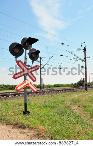 Traffic lights at a railway crossing and railroad.