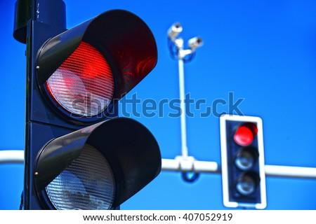 Traffic lights over blue sky. #407052919