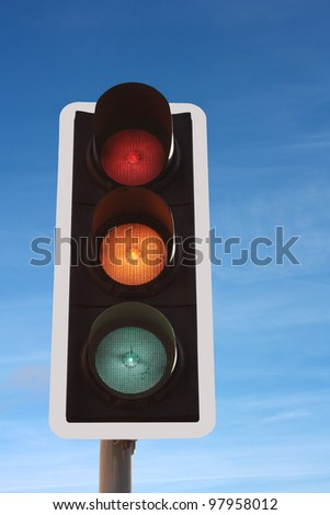 Traffic Lights red amber/orange green against blue sky