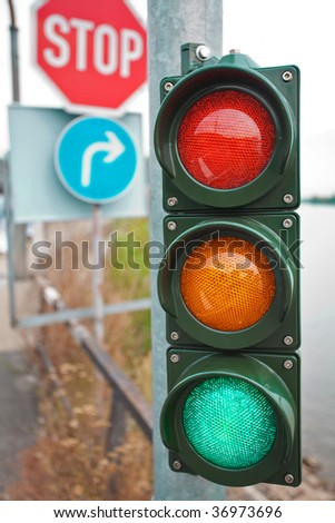 Traffic lights with road signs composition