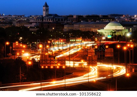 Traffic on a highway at night with a memorial in the background, Jefferson Memorial, Tidal Basin, Washington DC, USA