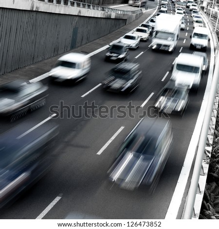 traffic on a highway in early morning