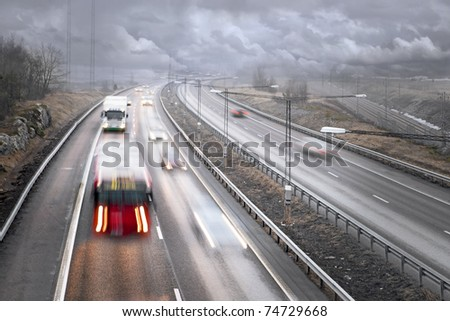 Traffic on highway on a foggy rainy day