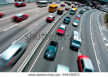 Traffic on multiple lane highway with motion blur
