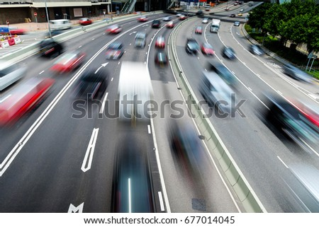 Traffic on multiple lane highway with motion blur  #677014045