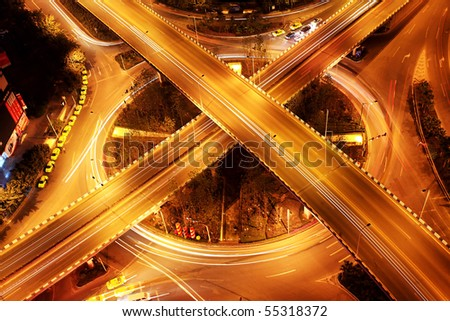 traffic on night road junction with long exposure
