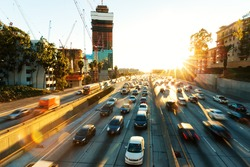 traffic on road in midtown of modern city