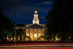 Traffic on Soldiers Field Road and building at Harvard Business School at night, in Boston, Massachusetts.