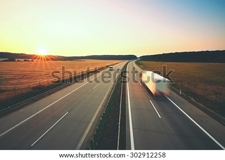 Traffic on the highway at the sunrise #302912258