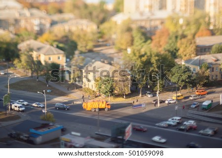 Traffic on the highway. Enchanting autumn. Blurry tilt-shift cityscape.  #501059098