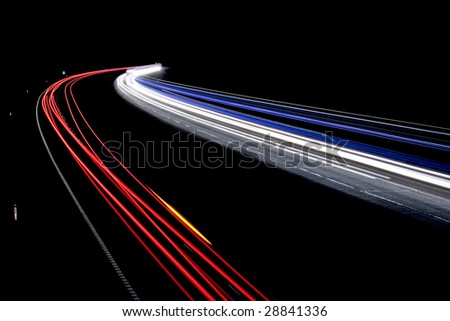 Traffic on the move at night on the M40 motorway in Warwickshire.