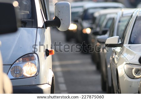 traffic on the road in a European city, stopping vehicular traffic, stop cars