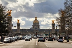 Traffic on the road to Les Invalides with the golden dome in Paris, France