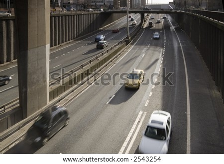 Traffic passes along city-centre motorway in the UK