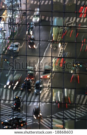 Traffic reflecting on building facade