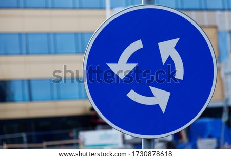 traffic sign circulation site, white arrows on blue background Stock photo ©