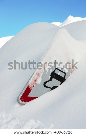 Traffic sign covered by a lot of snow