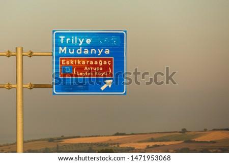 Traffic sign depicting the direction for Eskikaraagac province which is a European Stork Village (Avrupa Leylek Koyu) under preservation. Stok fotoğraf ©