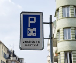 traffic sign, german text translation: blue zone, parking only allowed with parking disc, with parking card 8008 unlimited parking allowed